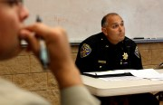 Captain Moser, of SFPD's Mission Branch, listens to community concerns at last night's public meeting.