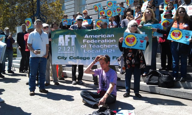 San Franciscans in front of City Hall rally in support of Proposition A. Photo by Erica Hellerstein.