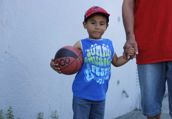 This young man was hanging with his dad, ready to hit the court for some basketball. Snapped near 17th and Folsom. Photo by Anne Hoffman.