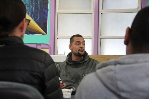 Ricardo Garcia-Acosta, Program Director of SF Community Response Network, addresses attendees of the Mission Peace Collaboration during a meeting.