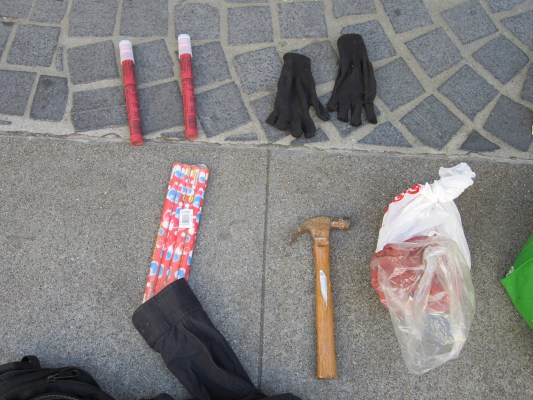 Flares, a hammer and illegal fireworks found when police searched suspects's backpacks. Photo courtesy of SFPD.