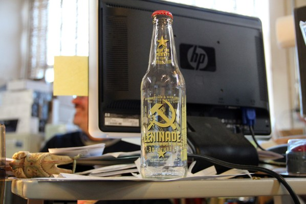 "An empty bottle of ""Leninade"" sits in front of Durham's computer."