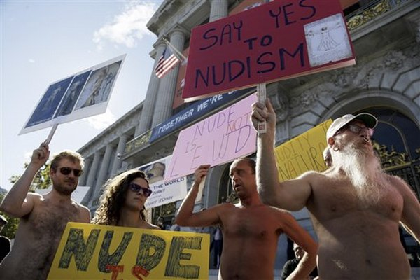 Demonstrators at a City Hall protest against the nudity ban. AP Photo/Marcio Jose Sanchez.