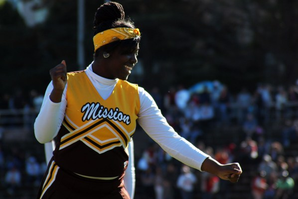 A Mission High School cheerleader performs her routine during the halftime show at Kezar Stadium.