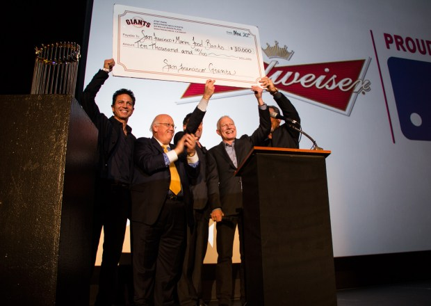 The San Francisco Giants donated enough money to the San Francisco and Marin Food Bank to supply 1,000 turkeys to those in need this Thanksgiving. From left: actor Benjamin Bratt, sports radio announcer Jon Miller, Giants CEO Larry Baer, Food Bank Executive Director Paul Ash and Giants Manager Bruce Bochy.