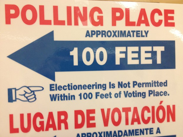 Bilingual signage at the Polling Place at City Hall for early voters Friday morning.