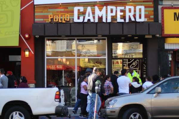 People started waiting in line early Monday morning to get a taste of Pollo Campero. Photo by Claudia Escobar.