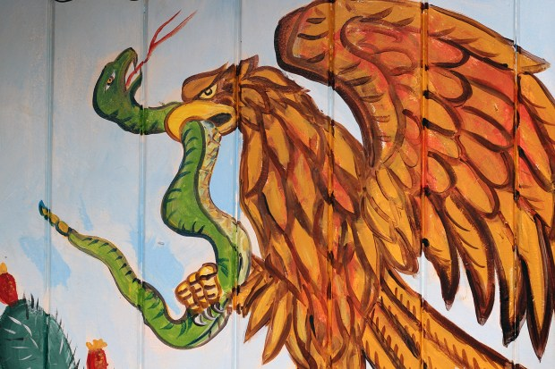 A mural on 24th Street depicting the Mexican Coat of Arms.