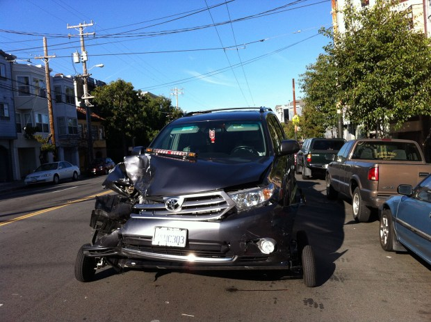 One of the cars that crashed against a parked car on South Van Ness and 24th Streets.