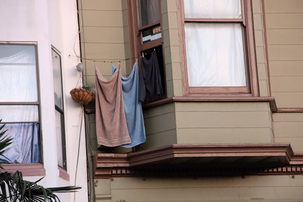 Laundry hangs from a window on Folsom Street. Photo by Molly Oleson