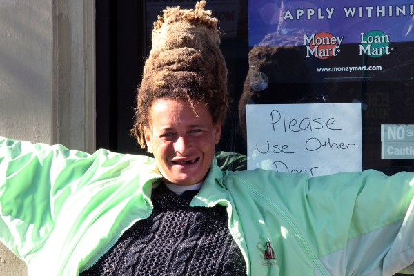 A woman shows off her hairdo on Valencia and 16th streets.