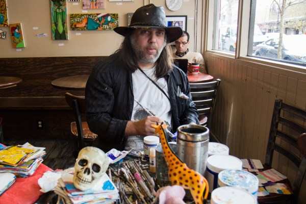 David Lovins goes to Muddy's Coffee House on Valencia Street every morning to paint paper napkins.