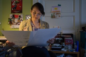 "Liz Mayorga looks at pages of ""Monstrous Love Stories"" in her apartment in the Mission."