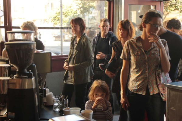 A crowd fills Linea Caffe an hour after its opening.