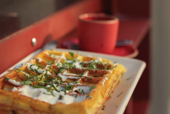 Lt. Waffle's egg souffle waffle, topped with chevre and herbs.