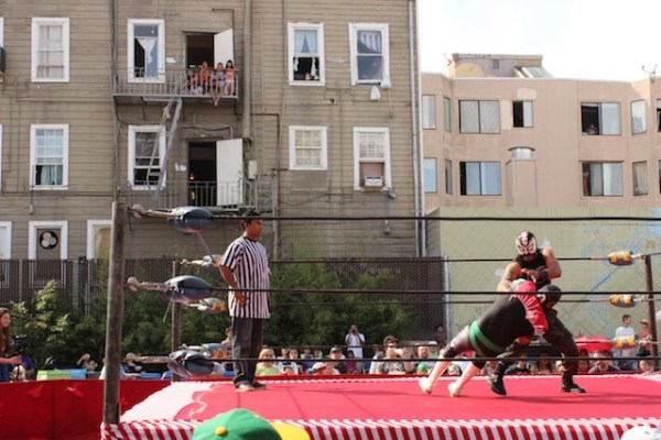 Attendees and neighborhood onlookers enjoyed the wrestling show. Photo by Heather Mack.