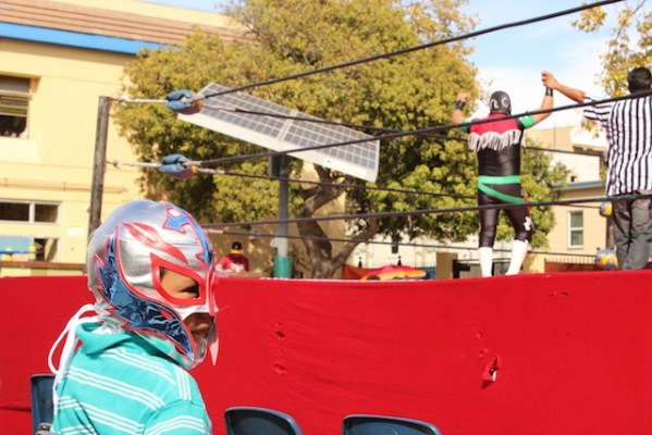 Children jumped at the chance to adorn themselves with luchador masks. Photo by Heather Mack.