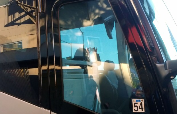 Apple employee inside the commuter bus snaps a photo of protest on December 20.
