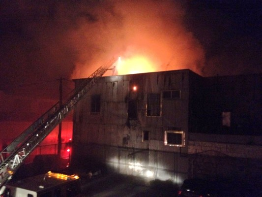 Fire burning section of Stevenson Street warehouse. Photo by Kyle Smeallie.