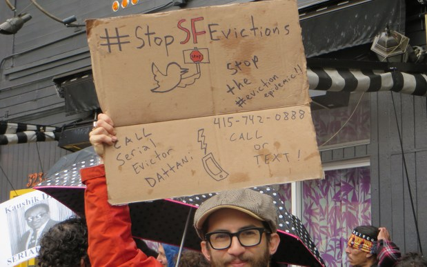 Protesters were carrying cardboard signs with popular hashtags during the protest.