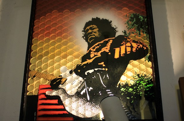A mixed media piece he made out of plastic bottle caps fiber glass and ink, based on a photo of Jimmy Hendrix. Photo by Claudia Escobar