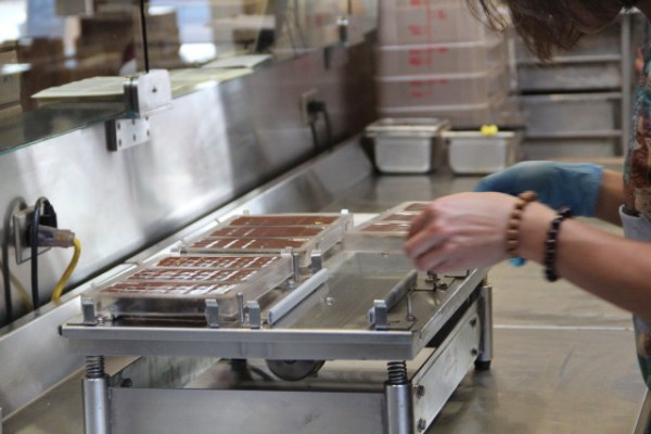 The chocolate is then cooled so it can be wrapped. Photo by Joe Rivano Barros.