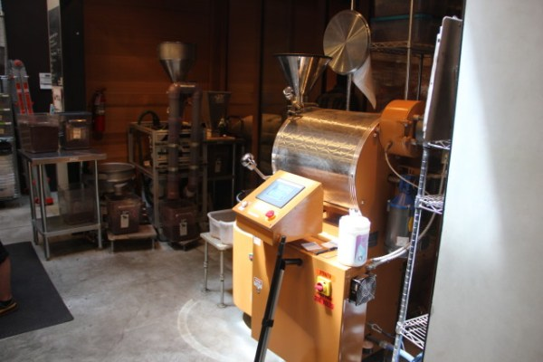 """""""Basically just a modified coffee roaster,"""" said Todd Masonis. The beans are spun for about a half-hour and then loaded onto a cooling tray. Photo by Joe Rivano Barros."""