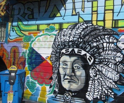 A fire damaged the first mural in 2008 and Cuba and Dino, another muralist painted this mural. The Mural of Chief's head, was painted by SPIE. Photo courtesy of rajah.