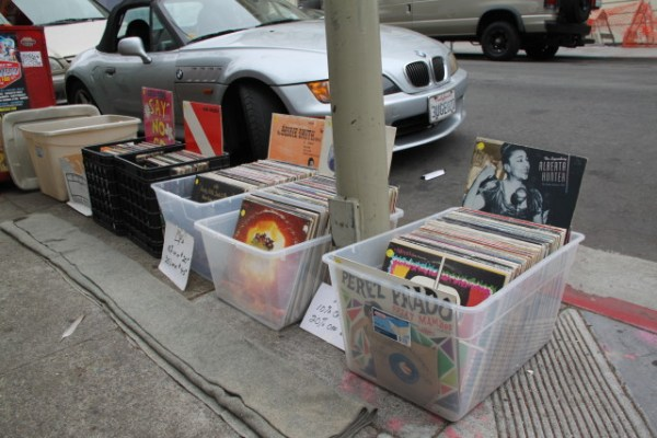 Records being sold outside Dogeared Books by a street vendor. Photo by Joe Rivano Barros.