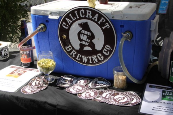 Local breweries (Calicraft, Drake's, 21st Amendment, and Anchor Steam) were serving half-cups of beer to those in the cordoned-off area (no open containers on Folsom Street). Photo by Joe Rivano Barros.