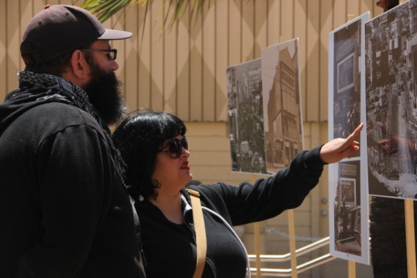By 1:30 p.m., 75 people had stopped by the community walking gallery to marvel at the photographs, noting the stark changes San Francisco had undergone over the years, according to organizers. Photo by Leslie Nguyen-Okwu.