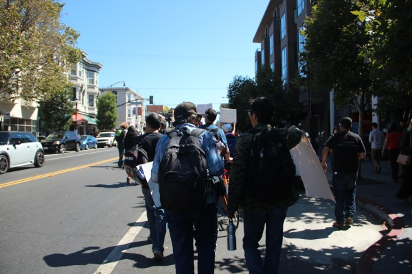 Protesters marched down Valencia Street as tourists watched and snapped pictures from the sidelines. Photo by Leslie Nguyen-Okwu.