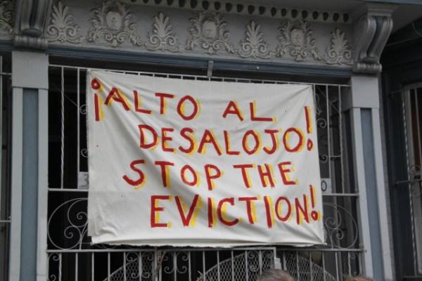 Tenants demanded that landlord Thomas Aquilina stop their eviction. Photo by Joe Rivano Barros.