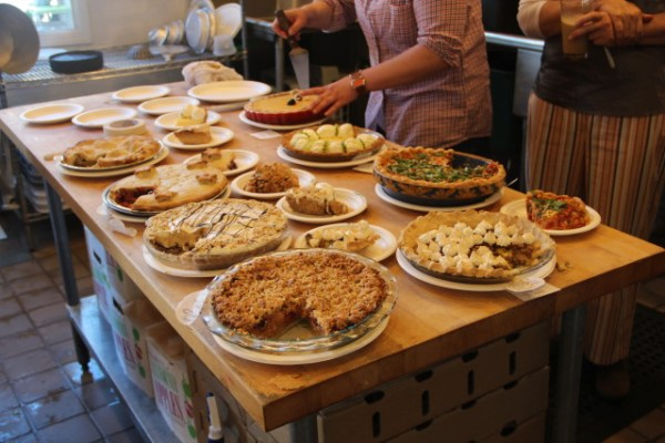 The assembled pies, ready to be sliced up and tasted by the panel of judges. Photo by Joe Rivano Barros.