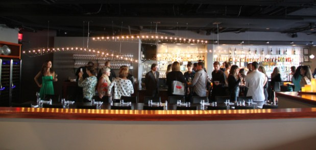 Some two dozen journalists made it to Plin's media preview, sipping wine and chatting away. Photo by Joe Rivano Barros.