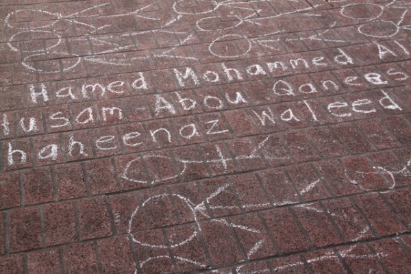 The names of some of the dead were written on the station's sidewalk. Photo by Joe Rivano Barros.