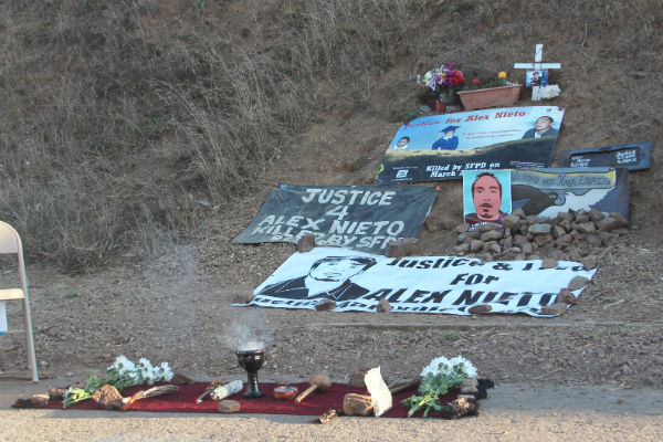 An altar on Bernal Hill commemorating Alex Nieto. Photo by Daniel Hirsch.