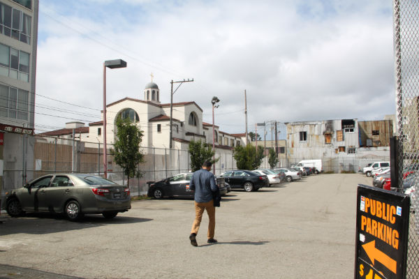 This parking lot is the proposed site of a luxury development. Photo by Daniel Hirsch.