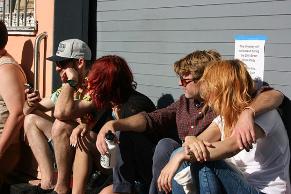 Block Partiers take a break on a loading bay ledge. Photo by Laura Wenus