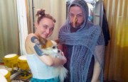 Anna Mouravitskya, Steven LeMay (in disguise) and Bacchus (the dog) at Retrofit. Photo by Daniel Hirsch.