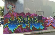 The first of many brightly-colored graffiti pieces on the block. Photo by Joe Rivano Barros.