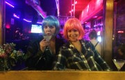Hailey  (left) and Alex (right) wore wigs while having drinks at Blondie's Bar, hoping for a real-time reaction. But it seems that making connections online is easier. Photo by Laura Waxmann