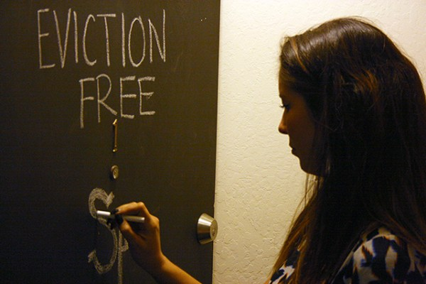 Tenant Bailey Nakano refreshes a chalked appeal on her apartment door.
