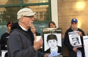 Father Richard Smith outside the Mission police station during one of his weekly vigils.