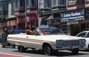 Lowriders cruise along Mission Street towards the Presidio on July 10. Photo by Laura Waxmann