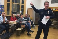 Captain Joseph McFadden, of Ingleside Police Station, addresses community members concerned about recent shootings in the Mission and in Bernal Heights. Photo by Laura Waxmann