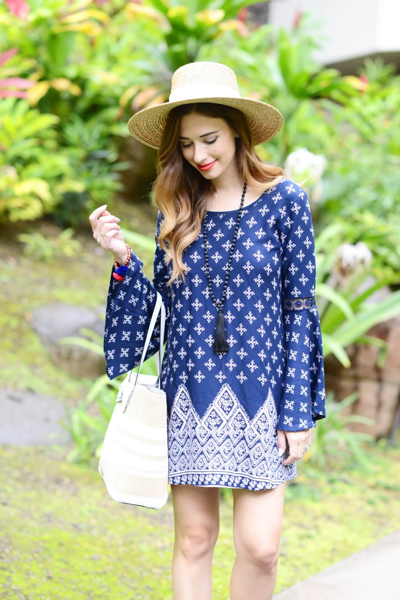 bell sleeve mini dress with tassel necklace