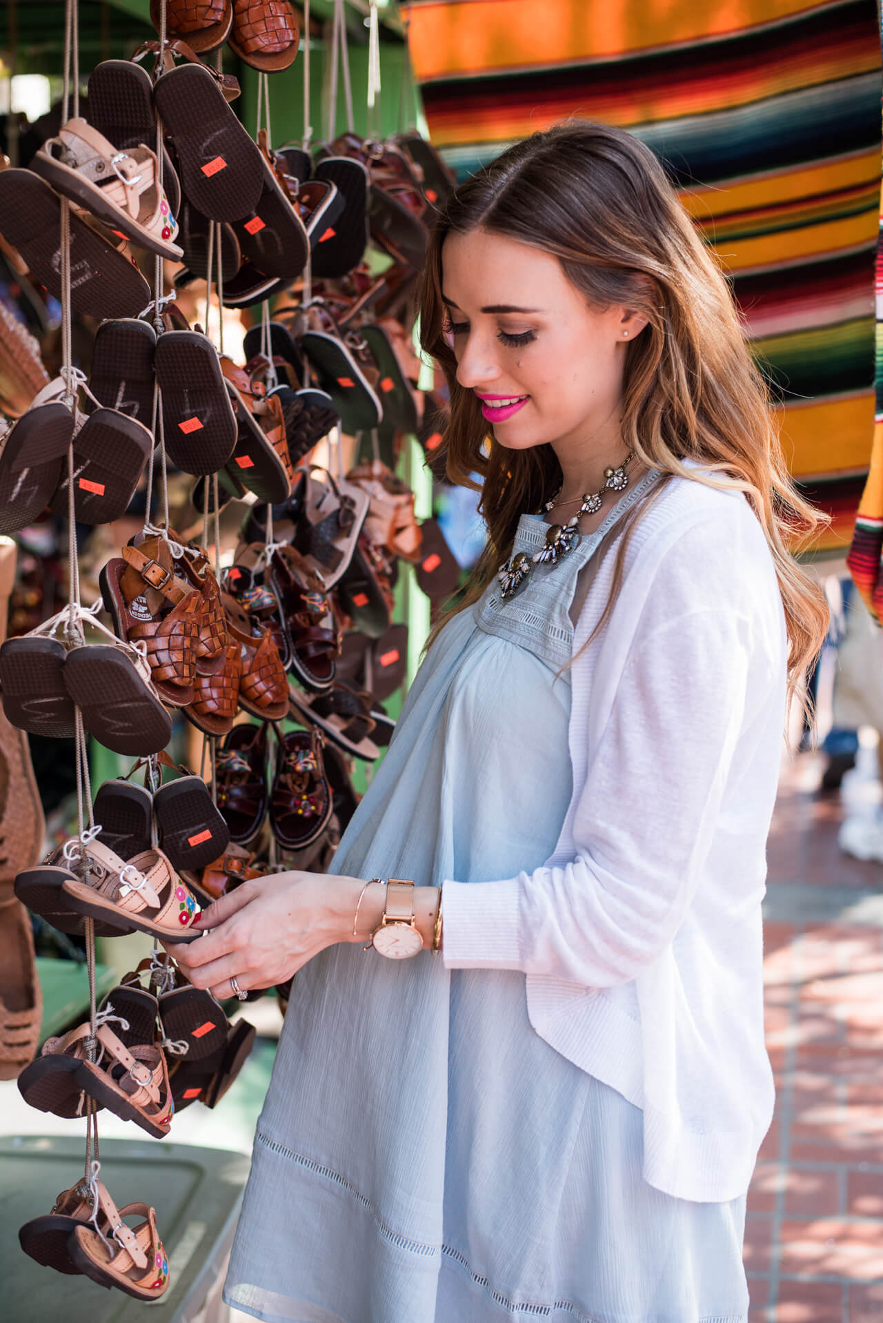 shopping olvera street in a light blue dress with white linen cardigan