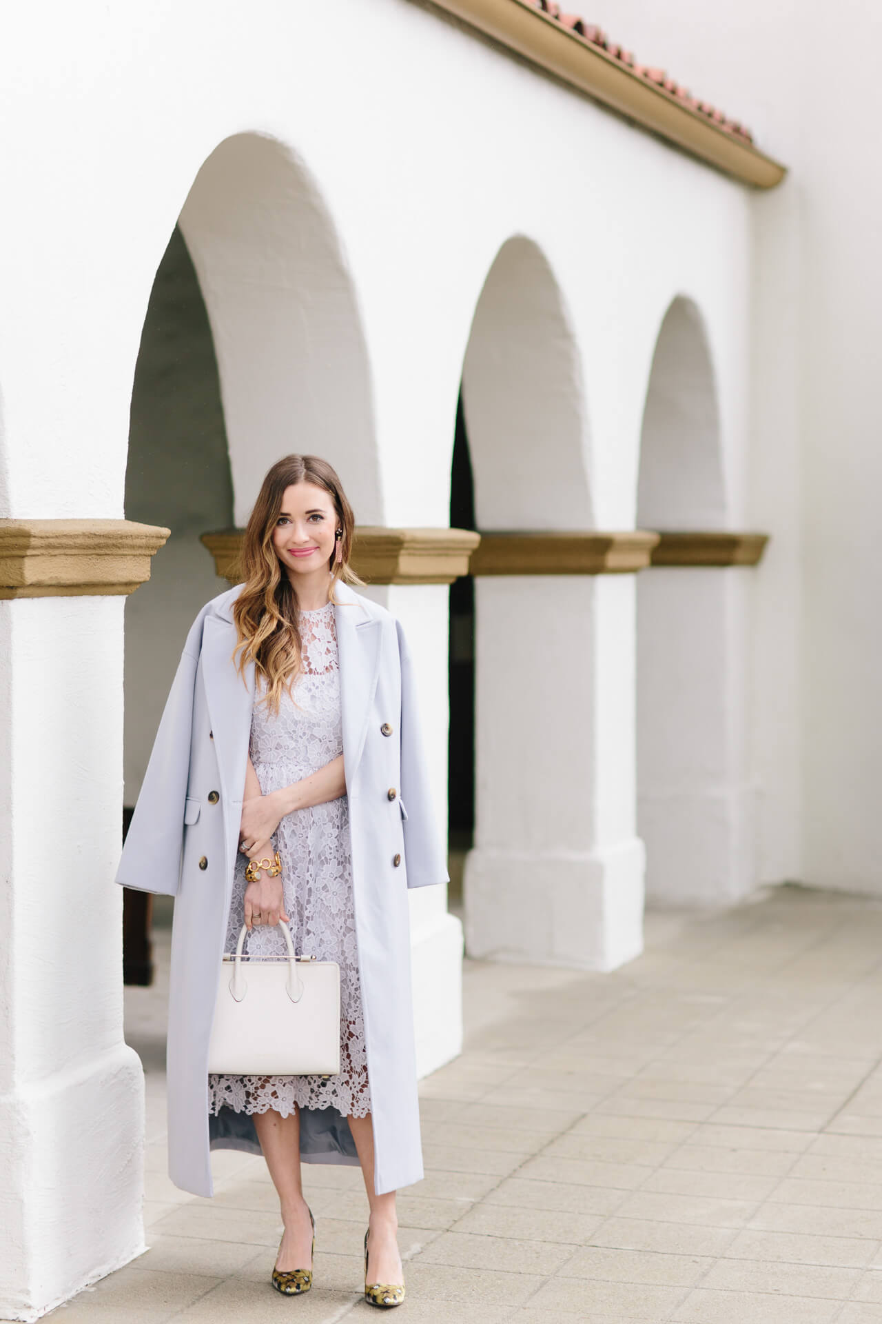 feminine early spring outfit with lavender coat and lace dress