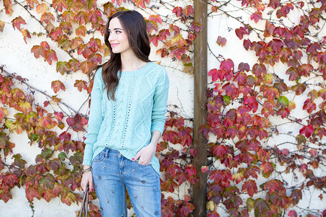 blue knit sweater with jeweled jeans by M Loves M